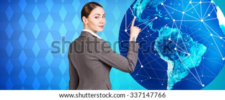 Woman stands near big earth ball on the blue rombus background. Elements of this image furnished by NASA