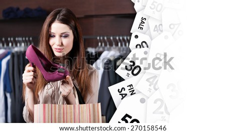 Woman stares at excellent fuchsia shoes at shopping center at affordable price - stock photo