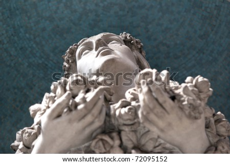 woman statue with eyes up - stock photo