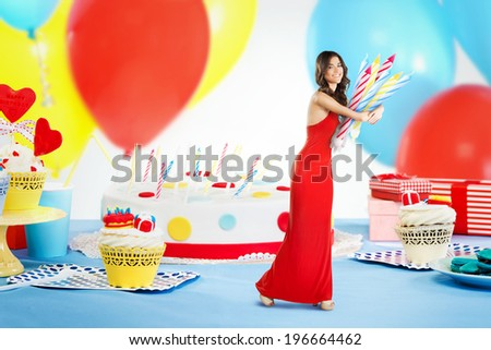 Woman stealing candles from a birthday cake