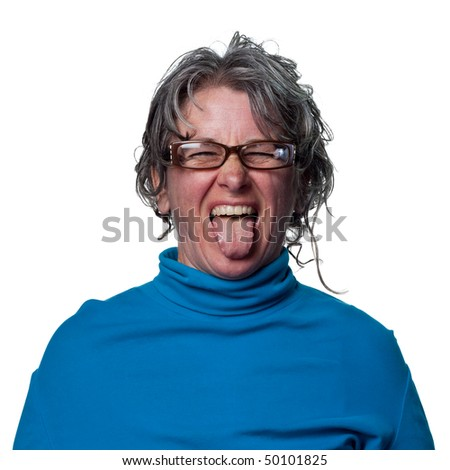 Woman sticks her tongue out at the camera - stock photo