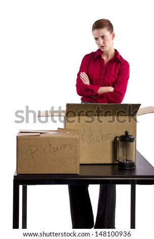 woman stressed out and packing stuff
