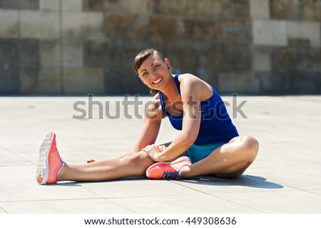 Woman stretching after, before jogging.