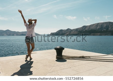 Woman stretching by the sea
