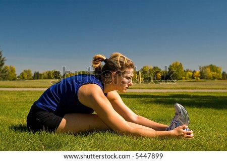 Woman stretching her hamstring. - stock photo
