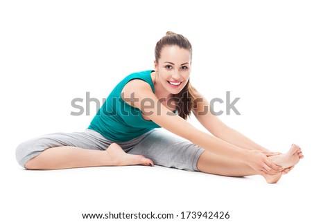 Woman stretching leg  - stock photo