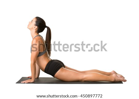 Woman stretching on the floor doing a yoga pose
