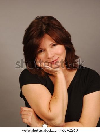 Woman striking a nonchalant pose of ambivalent interest - stock photo