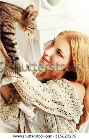 Woman stroking cat  - stock photo