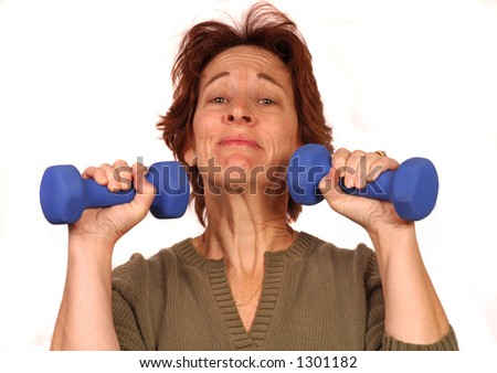 Woman struggles with two 5 lbs. weights - stock photo