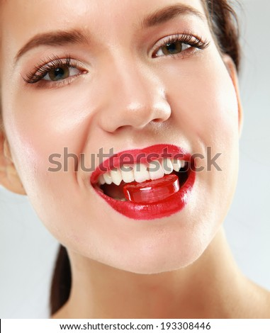 woman sucking cute sweet candy closeup - stock photo
