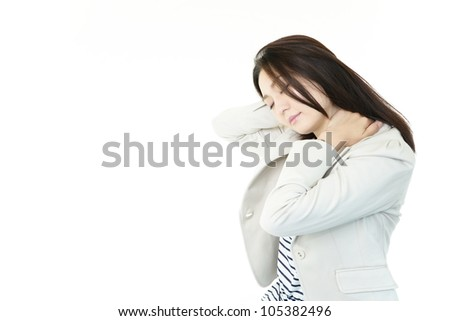 Woman suffer from stiff neck. - stock photo