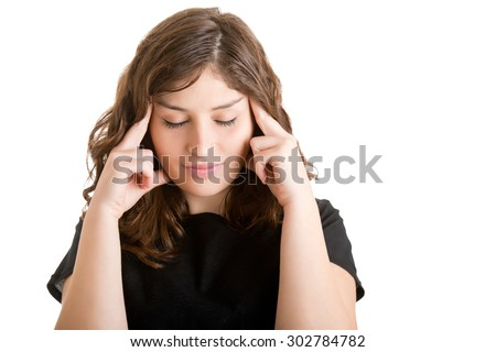 Woman suffering from an headache, holding her hand to the head - stock photo