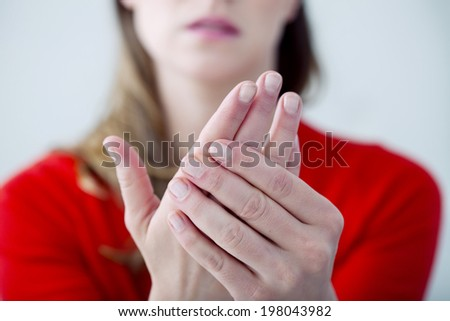 Woman suffering from hand pain. - stock photo