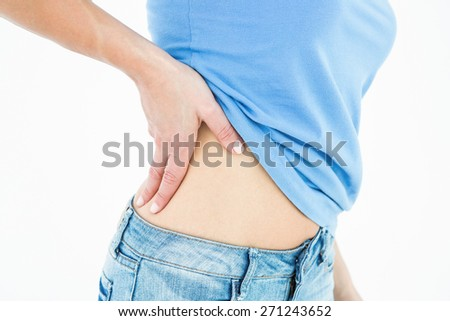 Woman suffering from ribbing pain on white background