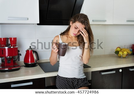 Woman suffering from the morning headache