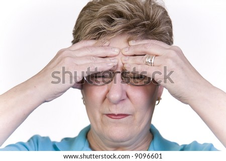 Woman suffering with headache pain - stock photo