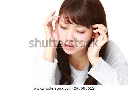 woman suffers from headache - stock photo