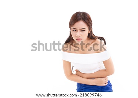 woman suffers from menstruation pain or stomach ache, with blank background for text space or copyspace - stock photo