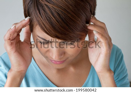 woman suffers from pain, headache, sickness, migraine, stress, insomnia, hangover in casual dress, two hands holding head - stock photo