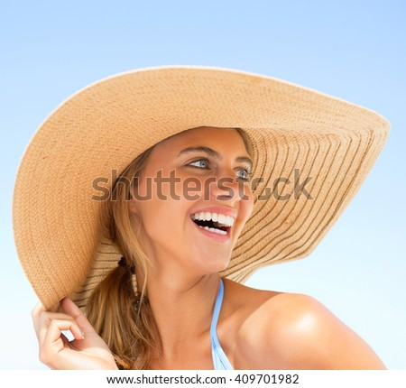 woman Sunbathing near swimming pool - stock photo