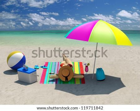 Woman sunbathing on the beach under a beach umbrella - stock photo