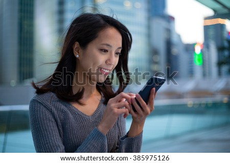 Woman surf the net by phone - stock photo