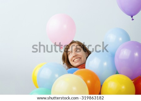Woman Surrounded by Balloons - stock photo