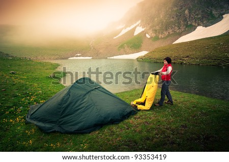 woman survives in extreme terrain - stock photo