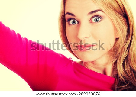 Woman sweating very badly have wet armpit - stock photo