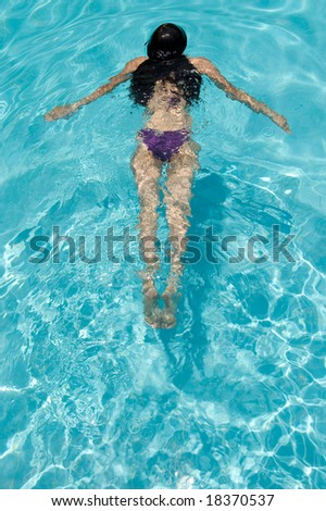 woman swimming at the pool - stock photo