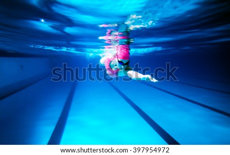 Olympic Swimming Pool Underwater woman swimming freestyle under water shoot stock photo 397954972