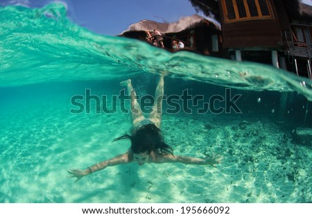 Woman swimming in Maldives, underwater photography