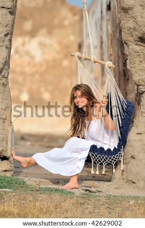 woman swinging outdoor - stock photo