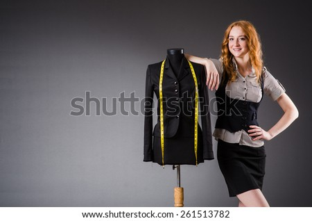 Woman tailor working on new dress - stock photo