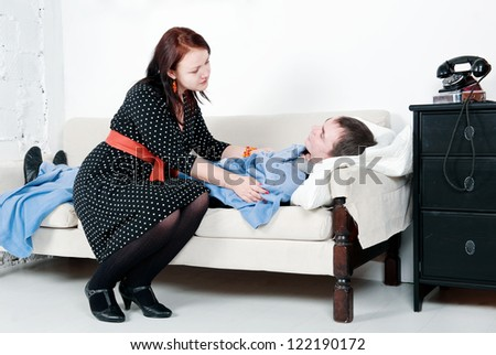 Woman take care of her sick man - stock photo