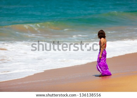 Woman takes rest at the sea shore - stock photo