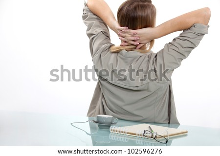 Woman taking a break from writing - stock photo