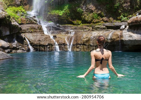 Woman taking a dip in a natural spring.  - stock photo