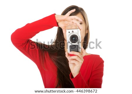 Woman taking a photo with a camera. - stock photo