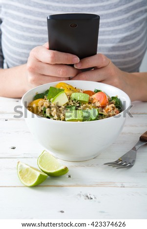Woman taking a picture to food with a mobile phone  - stock photo