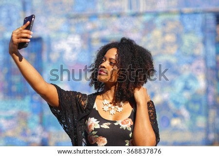 Woman taking a selfie stock image - stock photo