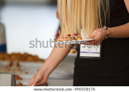Woman taking canape party catering