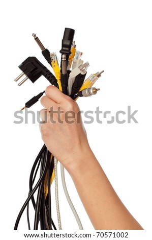woman taking different cables in the hand - stock photo