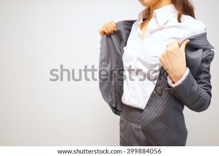 Woman taking her jacket after working