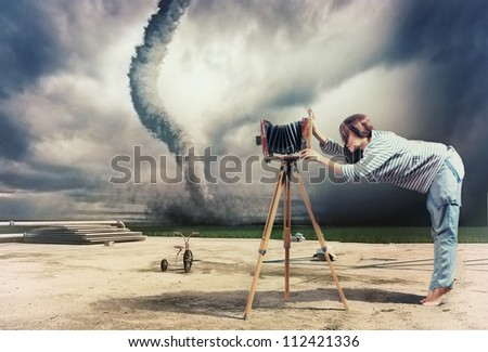 woman, taking photo by vintage camera and tornado (Photo compilation. Photo and hand-drawing elements combined. The grain and texture added.) - stock photo
