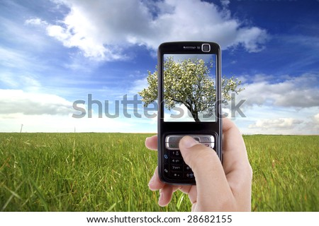 woman taking photo with mobile cell phone - landscape orientation - stock photo