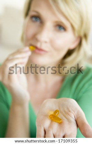 Woman Taking Pills - stock photo