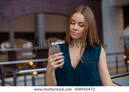 woman taking selfie in her office - stock photo