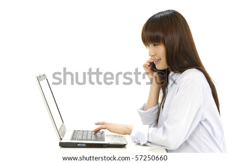 Woman talking on cell phone and using laptop